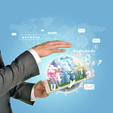 Man hands using tablet pc. Business city on touch screen. Earth as backdrop
