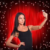Beautiful dancer makes selfie from your mobile phone