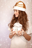 Teen girl holding Christmas gift