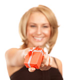 Happy woman offers gift box