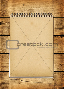 Blank vintage notebook on a wood board