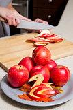 woman cutting apples