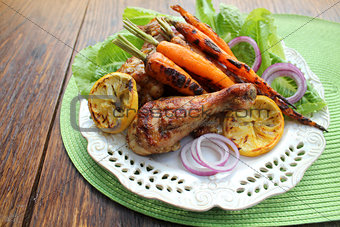 Grilled chicken legs and carrots