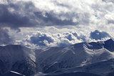 Evening sunlight mountain and silhouette of parachutist
