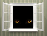 Eyes of monster  in open window