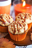 Carrot cupcakes with caramel cream cheese topping