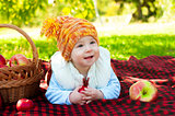 Little boy with apple in park