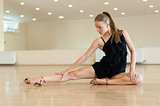 Young girl doing exercises indance class