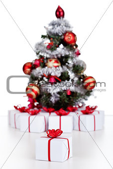 Small Christmas tree with lots of presents