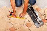 Phases of installing ceramic floor tiles - cutting the pieces