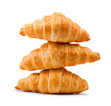 pile of fresh and delicious croissants on a white background