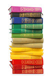 stack of colorful vintage books on white isolation