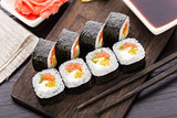Sushi rolls with salmon and vegetables