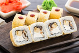 Sushi rolls with smoked eel and banana
