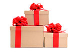 cardboard gifts boxes with red ribbon bows