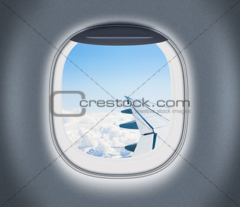 Airplane or aeroplane window with wing and cloudy sky behind. Ai