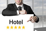 businessman pointing on sign hotel
