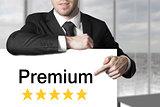 businessman in black suit pointing on sign premium