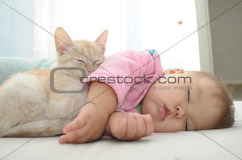 Baby and cat daytime sleeping
