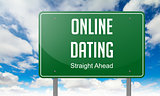 Online Dating on Green Highway Signpost.