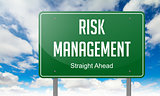 Risk Management on Highway Signpost.