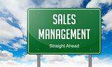 Sales Management on Highway Signpost.