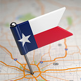 Texas Small Flag on a Map Background.