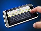 IT News in Search String on Smartphone.