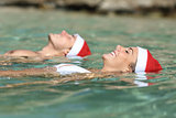 Couple swimming on the beach on christmas holidays