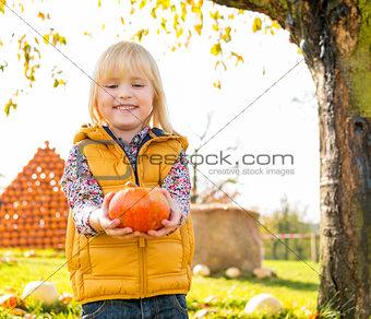Portrait of happy child with pumpkin