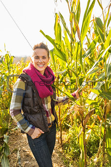 Portrait of smiling young woman in cornfield