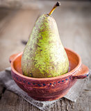 Green pear in rustic decor