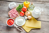 Ingredients for lasagne on the wooden background