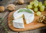 Camembert with walnuts and grape