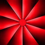 A red fan on dark background