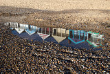 Relection of Beach Huts on Southwold Beach, Suffolk, England