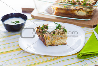 Cauliflower baked with eggs, cheese and dill on top