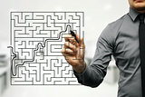 conceptual image of businessman trying to find way out of maze