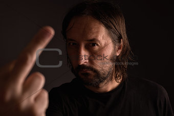 Aggressive man giving middle finger