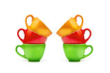 Colorful empty mugs over white background
