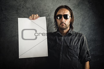 Adult bearded man holding blank paper