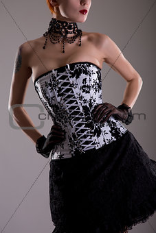 Attractive young woman in black and white corset