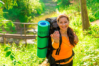 beautiful girl tourist invites a hike