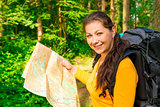 beautiful girl seeks the path to map forest