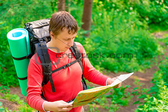 tourist is looking for its location on the map