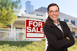 Young Woman in Front of House and Sale Sign