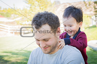 Caucasian Father Having Fun with His Mixed Race Baby Son