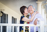 Attractive Chinese Couple Enjoying Their House