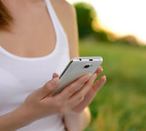 Woman Using Mobile Smart Phone Outdoors