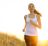 Young Beautiful Woman Running on the Trail in the Morning